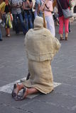 Kneeling Pilgrim in Assisi - prayer and redemption of a sinner Royalty Free Stock Photo