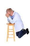 Kneeling senior praying. Royalty Free Stock Photos