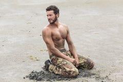 Kneeling Shirtless Soldier Stock Photo