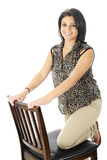 Kneeling on a Tall Chair Royalty Free Stock Photo