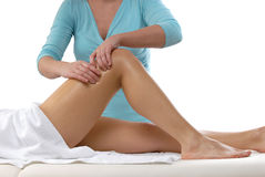 Knees massage. Therapist giving a knees massage Royalty Free Stock Photo
