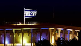Knesset with flying and waving Israel flag at night. Knesset building the Parliament of Israel with flying waving flag of Israel at night. The Knesset located in stock footage