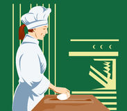 Knetender Teig des Chef-Kochs Stockfoto