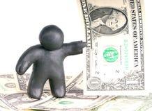 Knetmassemann mit einer Dollarbanknote Lizenzfreies Stockfoto