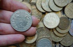 Kniaź monety w wyznaniach 1 hryvnia i inny, składających w obruszeniu Eagle i ogony obrazy stock