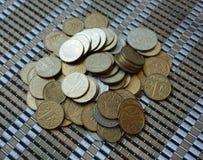 Kniaź monety w wyznaniach jeden hryvnia i inny, składających w obruszeniu Eagle i ogony obraz royalty free