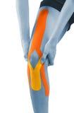 Knie met bandtherapie die wordt behandeld Royalty-vrije Stock Afbeeldingen