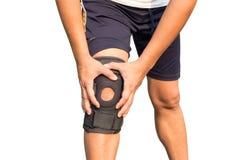 Kniestützklammer auf dem Bein lokalisiert auf weißem Hintergrund Lizenzfreies Stockfoto
