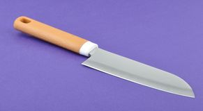 Knife. A knife in blue background Stock Photos