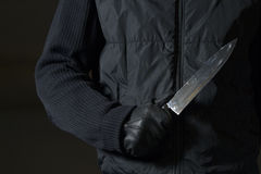 Knife. Man dressed in black holding a knife Royalty Free Stock Image