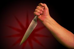 Knife. A hand holds a knife ready to stab. With clipping path so you can easily remove from background Stock Photography