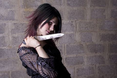 Knife. The girl in Gothic style holds the big knife royalty free stock photos