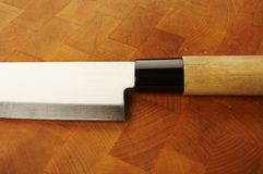 Knife. On the chopping wood Stock Images