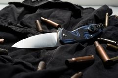 Knife ammunition on a black background. Military sleeves and knife royalty free stock image
