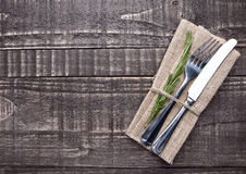 Free Knife And Fork Inside Kitchen Towel On Wooden Board Stock Images - 77682214