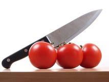 Knife And Tomatos Royalty Free Stock Photo