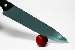 Knife and apple. On a white background Royalty Free Stock Photo