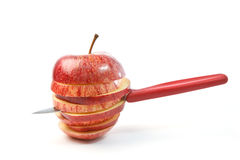 Knife in a  apple Stock Photography