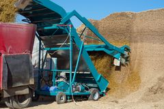 The knife assembly extracts the silage from the rammed pit and transports it stock images