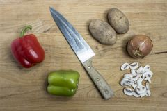 Knife and assorted veggies. royalty free stock photos