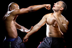 Knife Attack Self Defense. Martial arts instructor demonstrating self defense against a knife attack Stock Photo