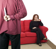Knife for backs man, woman in background Stock Images