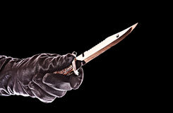 Knife in black glove isolated Royalty Free Stock Image