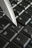 Knife blade on euro symbol key Stock Image