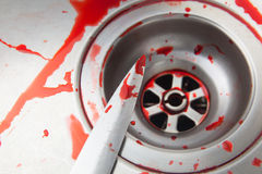 Knife and blood in the sink Royalty Free Stock Image