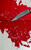 Knife and blood on tile floor Royalty Free Stock Photography