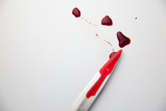 Knife and blood Royalty Free Stock Image