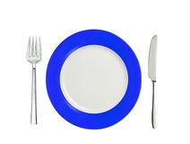 Knife, blue and white plate and fork, isolated on white Royalty Free Stock Image