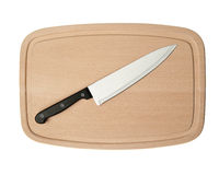 Knife and board for cutting food Royalty Free Stock Image