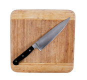 Knife on board Stock Photography