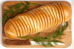Knife and bread on a board. Knife and cutting bread on a board Royalty Free Stock Photo
