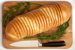 Knife and bread on a board. Knife and cutting bread on a board Royalty Free Stock Image