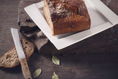 Knife with brown bread. On a plate Royalty Free Stock Photos