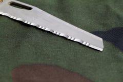 Knife on camouflage background Royalty Free Stock Photo