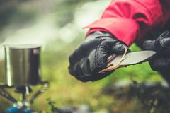 Knife and the Camping. Outdoor Survival Tools Closeup Photo. Stick Sharpening stock image