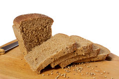 Knife, chopped rye bread. On a cutting board wooden Royalty Free Stock Photo