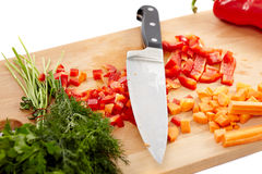 Knife and chopped vegetables Royalty Free Stock Images