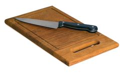 Knife on a chopping board Stock Images