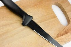 Knife and chopping board Royalty Free Stock Photo