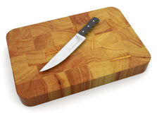 Knife on chopping board Royalty Free Stock Photography