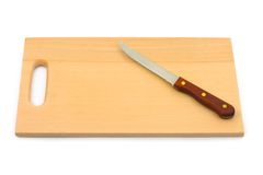 Knife and chopping board Stock Image