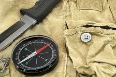 Knife and Compass on the Camouflage Bag Royalty Free Stock Photos
