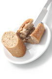 knife cuts bread on white Royalty Free Stock Photography