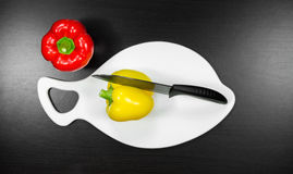 Knife Cuts Vegetables On A Cutting Board. Top View Stock Photos