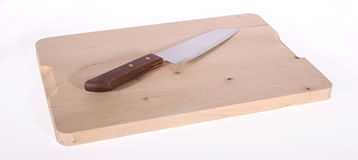 Knife on Cutting Board Stock Images