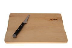 Knife on cutting board Royalty Free Stock Image